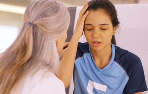 A concussed soccer player seeks help at the doctors office